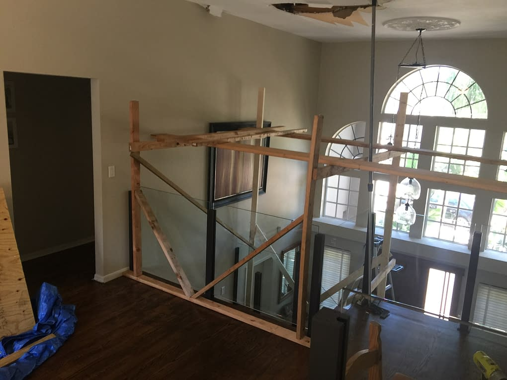 custom scaffold build to repair ceiling damage from roof leak