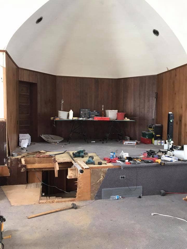 wood paneled stage area
