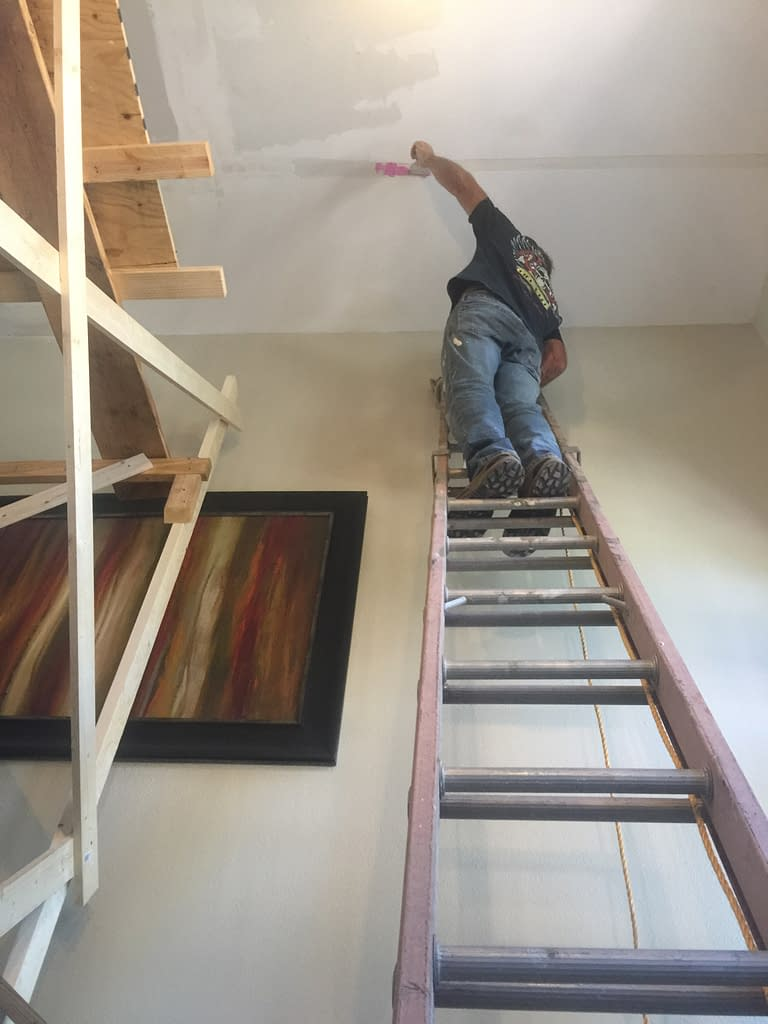 finishing touches to ceiling repair after roof leak